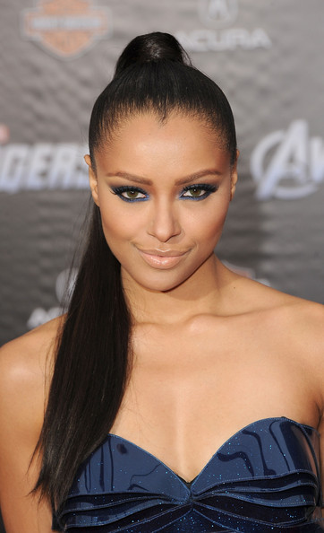 Kat Graham paired shimmering midnight blue shadow with her cool ultra modern-looking dress at the premiere of 'The Avengers.'