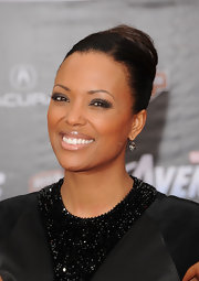 Aisha Tyler paired her ultra-sexy ensemble with a sleek classic bun for the premiere of 'The Avengers.'