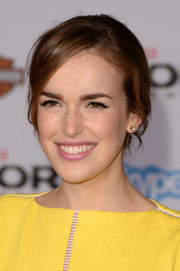 Elizabeth Henstridge went for simple elegance with this chignon at the premiere of 'Thor: The Dark World.'