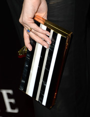 Judy Greer went to the premiere of 'Carrie' carrying an elegant striped box clutch.