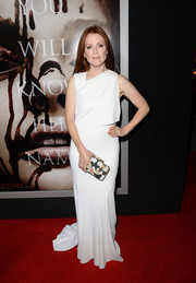 Julianne Moore exuded simple elegance in a flowy white evening dress with an asymmetrical neckline during the premiere of 'Carrie.'