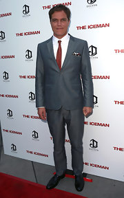 Michael Shannon chose a gray suit and a red tie for the premiere of 'The Iceman.'