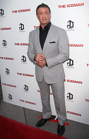 Sylvester Stallone paired a gray suit with a black button-down for a dapper finish at the 'Iceman' premiere.