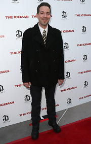 Hector Hank chose a classic black pea coat for the premiere of 'The Iceman.' The skinnies and boots added a rugged feel.