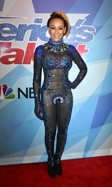 Melanie Brown attended the premiere of 'America's Got Talent' season 12 dressed like a glamorous superhero in this bejeweled catsuit by Rocky Gathercole.