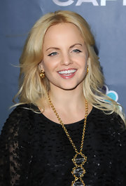 Mena Suvari styled her long layered locks into large curls. A sleek center part completed her look.