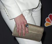 Lauren Graham sported a simple gold clutch to spice up her white suit. The subtle added color gave her outfit some dimension.