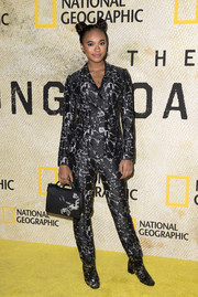 Chandler Kinney suited up in this printed jacket and pants combo for the premiere of 'The Long Road Home.'