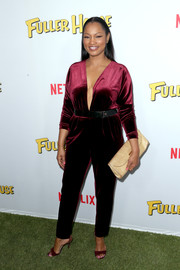 Garcelle Beauvais worked a berry-hued jumpsuit with a navel-grazing plunge during the premiere of 'Fuller House.'