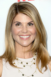 Lori Loughlin stuck to her usual face-framing layered style when she attended the premiere of 'Fuller House.'