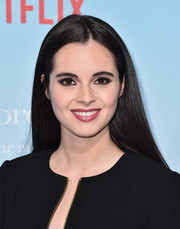 Vanessa Marano wore her hair loose and straight with an off-center part at the premiere of 'Gilmore Girls: A Year in the Life.'