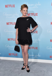 Virginia Madsen showed off her fabulous pins in a little black dress with a fringed hem at the premiere of 'Gilmore Girls: A Year in the Life.'