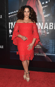 Dascha Polanco styled her lovely dress with a pair of nude platform sandals.