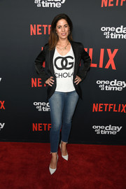Ana Ortiz was casual on the red carpet in skinny jeans and a graphic top at the premiere of 'One Day at a Time' season 2.