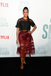 Regina King pulled her look together with a pair of black gladiator heels.