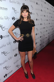 Lake Bell complemented the gold accents in her belt with funky black suede ankle boots with gold mesh detailing.