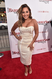 Adrienne Bailon put her hourglass figure on display in a laced houndstooth strapless dress by House of CB at the premiere of 'Barbershop: The Next Cut.'