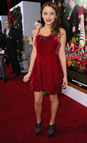 Jordan Hinson got on the Christmas theme in a red velvet dress adorned with rosettes for the 'Harold and Kumar' premiere.