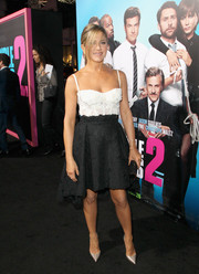 Jennifer Aniston looked flirty and feminine in a black-and-white high-low corset dress by Zuhair Murad at the 'Horrible Bosses' premiere.