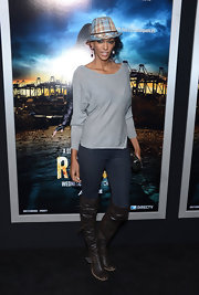 Judi Shekoni chose brown over-the-knee boots with buckles for her casual but cool look at the 'Rogue' premiere.