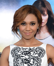 Toks Olagundoye chose a classic bobby-pinned updo with cascading waves for her subtle red carpet look at the premiere of 'Rogue.'