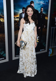 Leah Gibson chose a white floor-length gown with gold splatter-print for her red carpet look at the 'Rogue' premiere.