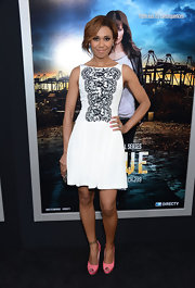 Toks Olagundoye chose a white frock with lace detailing on the bodice for her fun and flirty look at the 'Rogue' premiere.
