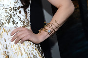 Leah Gibson chose this funky gold bracelet that resembled a snake for her slightly edgy red carpet look.