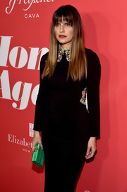 Lake Bell paired a green Edie Parker box clutch with a collared LBD for the premiere of 'Home Again.'