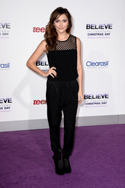 Alyson Stoner chose a casual yet chic mesh-panel jumpsuit for the premiere of 'Justin Bieber's Believe.'