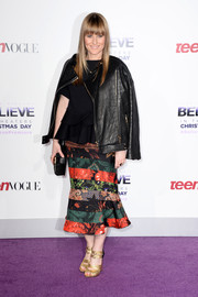 Amy Astley added a touch of edge to her look with a black leather jacket when she attended the premiere of 'Justin Bieber's Believe.'