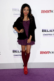 Teala Dunn attended the premiere of 'Justin Bieber's Believe' looking breezy in a black cardigan layered over a gingham mini dress.