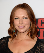 Laura Prepon went for a boho vibe with this center-parted wavy hairstyle at the 'Machete Kills' premiere.
