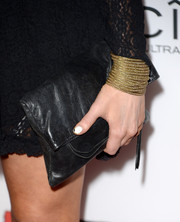 Laura Prepon accessorized with a simple black leather clutch when she attended the 'Machete Kills' premiere.