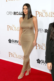 Kim Kardashian flashed her voluptuous figure in a vintage Gianni Versace Haute Couture dress at the premiere of 'The Promise.'