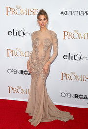 Kara Del Toro made a sultry appearance at the premiere of 'The Promise' wearing a sheer nude gown with strategically placed beading.