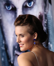 Maggie Grace wore her hair in a classic bun with twisted sections in the front at the premiere of 'The Grey.'