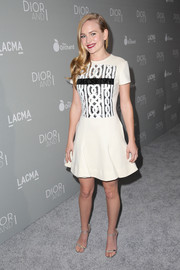 Britt Robertson went for modern femininity in a white cocktail dress with a fluted hem and a sequined bodice during the 'Dior and I' premiere.