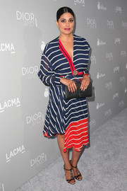 Rachel Roy looked effortlessly chic in a tricolor striped dress with an asymmetrical hem during the 'Dior and I' premiere.