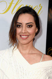 Aubrey Plaza styled her hair into a loose chignon for the premiere of 'Flower.'