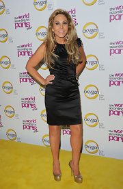 Adrienne Maloof added some shimmer to her look with a pair of gold platform pumps.