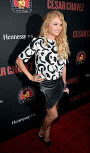 Paulina Rubio teamed her blouse with a sexy-edgy black leather mini skirt.