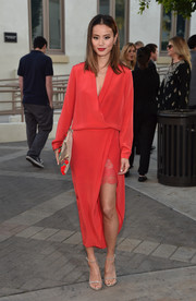 Jamie Chung looked oh-so-classy in a red Mason by Michelle Mason wrap dress, featuring a sultry lace-embellished thigh-high slit, during the premiere of 'Resident Advisors.'