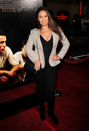 Tia Carrere completed her simple-yet-chic look with a quilted Chanel leather bag for the premiere of 'The Fighter.'