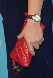 Marcia Gay Harden brightened up her dark navy blue shift with this quilted Chanel clutch.