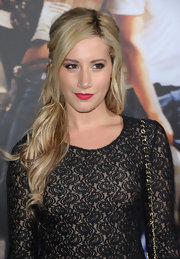 Ashley Tisdale wore her long blond locks in subtle waves and partly pulled up at the 'Footloose' premiere. She also created a side part and swept her bangs off to the side.