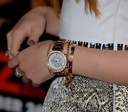 Bella Thorne got in on the rose gold trend with this beautiful Michael Kors watch and matching stacked bangles.