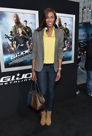 Lisa Leslie chose a gray blazer to pair with a yellow blouse and jeans for her red carpet look.