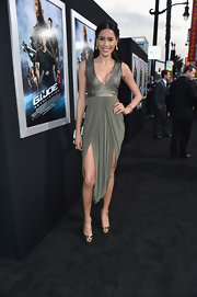 Rebecca Da Costa showed off some major skin with this shimmery green gown with a plunging neck.