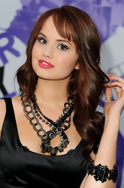 Debby Ryan perfectly paired her layered statement necklace with an equally stunning black bracelet.